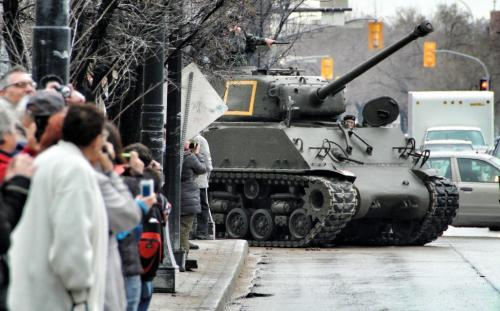 """A convoy of military vehicles including a 34 Ton M4A2 Sherman Tank of the type used by the Fort Garry Horse Regiment in World War Two paraded down Main Street towards the Legislative Building in the Freedom of the City parade.  The Freedom of the City parade is a ceremony to reaffirm and permit the Fort Garry Horse Regiment to exercise the traditional right of """"Freedom of the City"""" granted some years ago. The Fort Garry Horse Regiment is also celebrating 100 years of service to the community and the country. 120414 April 14, 2012 Mike Deal / Winnipeg Free Press"""