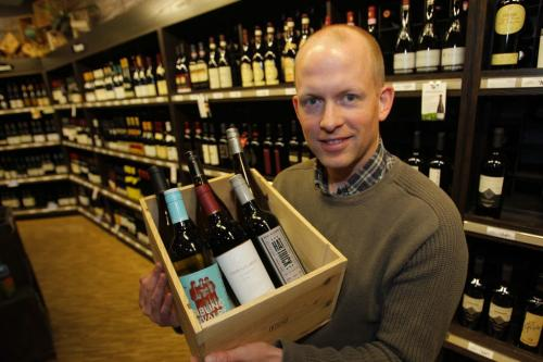 Ben MacPhee-Sigurdson writes about wine in the Winnipeg Free Press. Here he poses with some Canadian wine he is writing about. Photo taken at Madison Square LC. May 3, 2012  BORIS MINKEVICH / WINNIPEG FREE PRESS