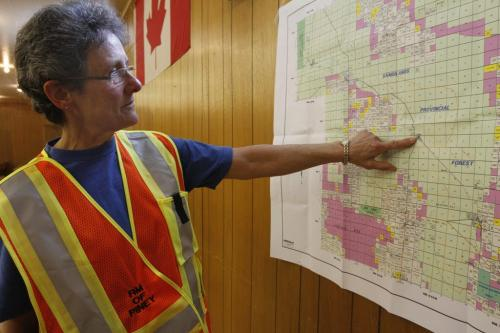 Donna Stewart of Badger, MB, traces the progression of the forest fires towards the town of Badger, which was evacuated the previous night. Several fires are currently being fought in southeastern Manitoba. May 14, 2012. SARAH O. SWENSON / WINNIPEG FREE PRESS