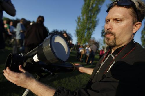 May 20, 2012 - 120520  -  Bryan Stach of the Royal Astrological Society of Canada and organizer of the viewing event adjusts his telescope projection for curious star gazers at Assiniboine Park. Winnipeggers hit Assiniboine Park to catch a glimpse of a partial eclipse Sunday May 20, 2012.    John Woods / Winnipeg Free Press