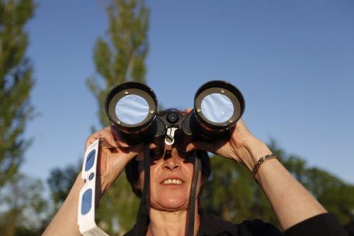 May 20, 2012 - 120520  -  Curious star gazer Bernice Wiebe catches a glimpse of the solar eclipse through mylar covered binoculars at Assiniboine Park. Winnipeggers hit Assiniboine Park to catch a glimpse of a partial eclipse Sunday May 20, 2012.    John Woods / Winnipeg Free Press