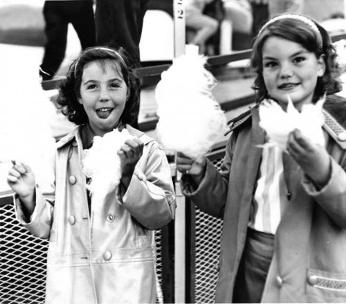 Winnipeg Free Press Archives July 3, 1961 Red River Exhibition Parade. (l-r) Linda Jackin, 9, and Nancy Flavell, 9, enjoy treats at the parade.