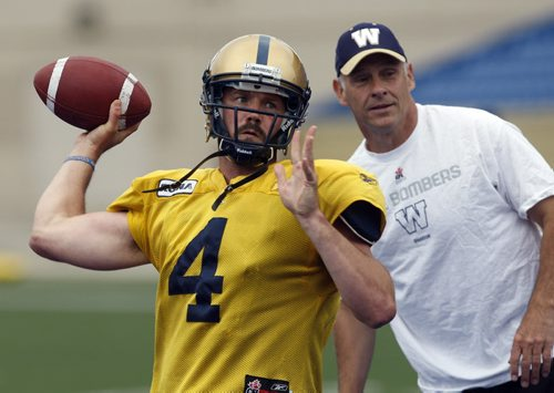 STDUP - HANDS ON COACH- Offensive Co ordinaor  Gary Crowton  keeps a close eye  during QB accuracy and footwork drill with QB Buck Pierce  at Canad Inn Stadium practice  - adam wozny story  -KEN GIGLIOTTI  / WINNIPEG FREE PRESS  /  June 26 2012