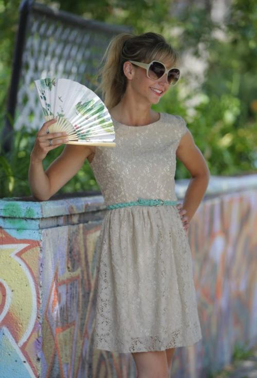 SUMMER KEEPING COOL FASHION. Lace low back cocktail dress with turcoise belt and sunglasses paper fan. July 9, 2012  BORIS MINKEVICH / WINNIPEG FREE PRESS
