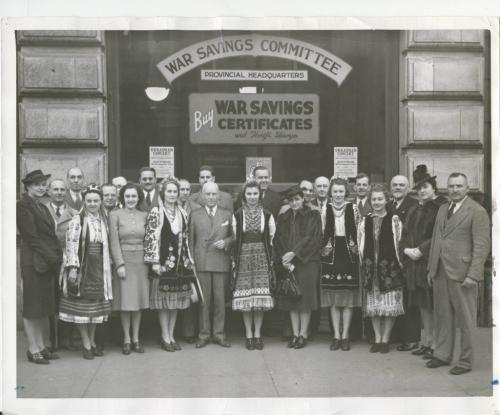 Winnipeg Free Press Archives Winnipeg WWII Home Front October 19, 1940 Their efforts will aid Canada To raise funds for carrying on the battle. Winnipeg Ukrainians are staging 'a war savings concert at the civic auditorium at 8.30 p.m., Wednesday. Oct. 23. Seen above are some of the performers and the war savings committee. Those taking part will include the Topper male quartet, radio artists; the Dizzy Dozen, also heard on the air; the CBC Harmonettes. and Luba Novak. Constance Stefanik, Donna Grescoe and Joan Maraz, concert artists. Ukrainian folk dances will afford opportunities lor the display ot gorgeous national costumes, and the Ukrainian choir and Ukrainian orchestra will present several numbers. The band of the Royal Winnipeg Rifles will play from 8 p.m. to 8.30 p.m. Admission to the concert is free to the purchasers of two war savings stamps and a ten-cent programme. These are on sale at J. J. H. McLean and company, limited; Winnipeg Piano company, limited: Harmony Music Store. City Hydro Showrooms. Portage avenue, and War Savings committee headquarters at 356 Main street.