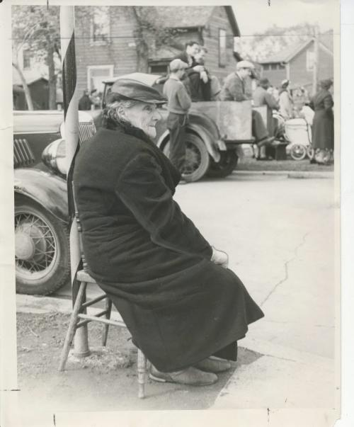 Winnipeg - Manitoba Roars Rousing Western Welcome to Royality This elderly resident of Winnipeg's north end is displaying patience as, comfortably sealed along the route of the royal procession, on Salter street, she awaits the arrival o£ King George VI and Queen Elizabeth. May 25 1939. fparchive