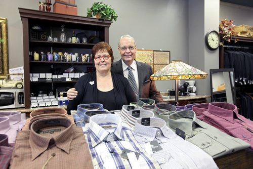 Brandon Sun 13072012 Gwen and Brian Bromley, owners of the Cinnamon Tree and Bromley's Mens Wear respectively, pose for a photo in the Bromley's section of the storefront they now share at 934 Rosser Ave. on Friday. (Tim Smith/Brandon Sun)
