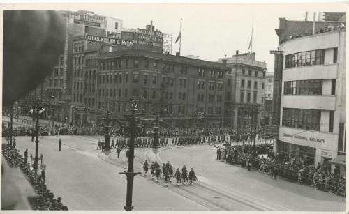 Winnipeg Free Press Archives Wartime Winnipeg (06) May 23, 1944 Army Day Parade on street car streetcar rails, Main Street heading north from Portage Avenue. fparchive