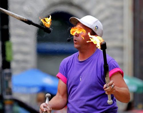 Fringe at Old Market Square - Chris Without the Hat juggles fire for the crowds. July 18, 2012  BORIS MINKEVICH / WINNIPEG FREE PRESS