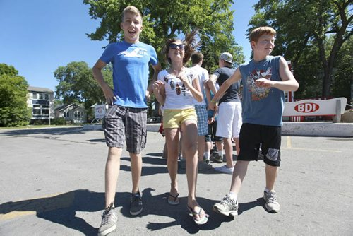 Windsor School Class of 2017 Grade seven students spend their last day of school going for ice cream to the BDI, signing year books and saying goodbye's to their grade eight classmates that are moving on to high school and Han an exchange student who is going home after spending a year with her classmates in Canada. See Doug Speirs story. Also see more photo's taken June 20. Names From left - Liam, Aby and Griffin do a little dance while waiting in a long line for icecream on their last day of school. June 29,  2012 (Ruth Bonneville/Winnipeg Free Press)