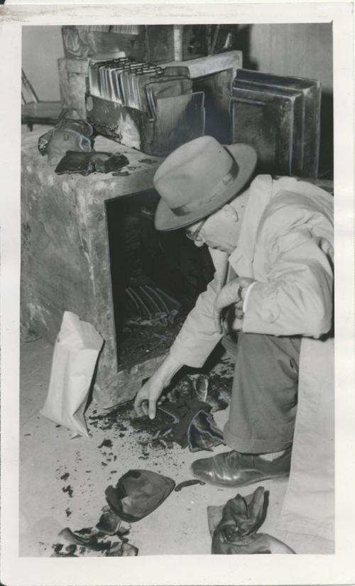 Winnipeg Free Press Archives Time Building Fire  (11) June 10, 1954 Two steel safes were salvaged Wednesday from the smouldering ruins of Dayton's Ltd., on the corner of Portage avenue and Hargrave street. In this picture, R. E. Coddington of the National Cash Register examines some of the charred paper money and blackened coins removed from one of the safes. fparchive