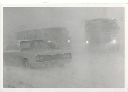 Jack Ablett/Winnipeg Free Press Archives Winnipeg Blizzard (20) March 4, 1966  Traffic on Portage Avenue at Polo Park at 8:30 a.m. Friday was barely visible. fparchive