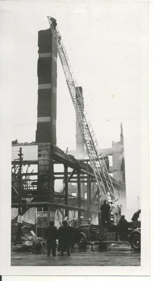 /Winnipeg Free Press Archives Time Building Fire (18) June 9, 1954  On the left, workmen from  R. Litz and Sons.  moved away. The ariel ladder has moved away. A brief  moment later the pillar toppled and crumbled. fparchive
