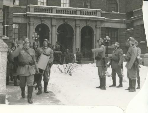 Winnipeg Free Press Archives If Day - World War II - (11) Feb. 19, 1942 Nazi Storm Troopers Demonstrate Invasion Tactics Looting begins as Nazi troopers carry furniture and household goods from Devon court, on Broadway.  fparchive