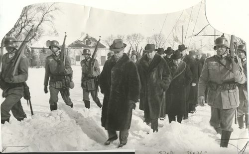Winnipeg Free Press Archives If Day - World War II - (14) Feb. 19, 1942 Nazi Storm Troopers Demonstrate Invasion Tactics Premier Bracken, Hon. Errick Wills and other members of the cabinet and civic officials on their way to cells at Lower Fort Garry. fparchive