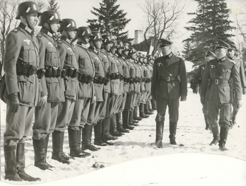Winnipeg Free Press Archives If Day - World War II - (17) Feb. 19, 1942 Nazi Storm Troopers Demonstrate Invasion Tactics Premier Bracken, Hon. Errick Wills and other members of the cabinet and civic officials on their way to cells at Lower Fort Garry. fparchive