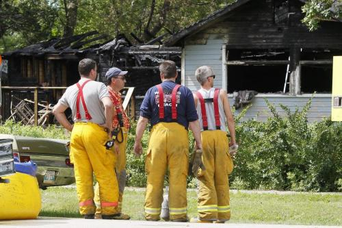 August 5, 2012 - 120805  -  Winnipeg Beach firefighters look at the charred shell of a Prospect Street home in Winnipeg Beach where two people died and one was sent to a Winnipeg hospital early Sunday morning August 5, 2012.    John Woods / Winnipeg Free Press