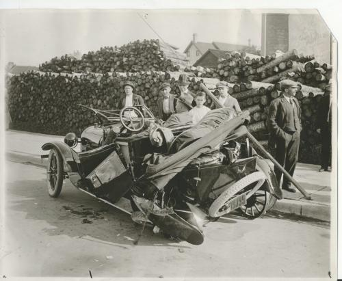 L.B. FOOTE/Winnipeg Free Press Archives Winnipeg storm  (4) June 17, 1919 Winnipeg scenes following wind storm  SECTION OF ROOF BLOWN ONTO CAR This is the automobile in which ex-Chief MacPherson and Mr. and Mrs. McKenzie were riding when the   car and occupants were struck by a large section of apartment block roofing blown from King to Main street. fparchive