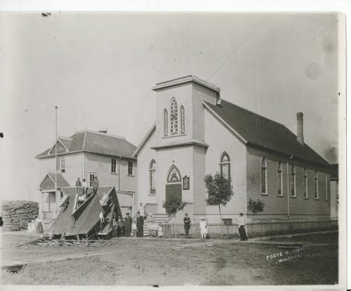 L. B. Foote / Winnipeg Free Press Winnipeg storm  (9) June 17, 1919 Winnipeg scenes following wind storm CUPOLA AND STEEPLE REMOVED The Evangelical Lutheran (German) church on the southwest corner of College and McKenzie. The steeple and cupola.may be seen on the street in front of the edifice. fparchive