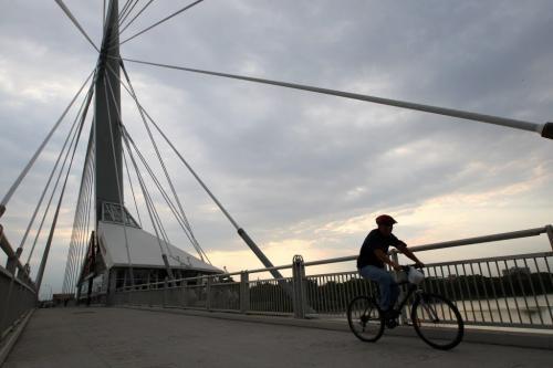 Cyclist rides over the Esplanade-Riel-pedestrian-bridge over the Red River Tuesday morning during a  seasonable cool morning- Standup photo– September 11, 2012   (JOE BRYKSA / WINNIPEG FREE PRESS)
