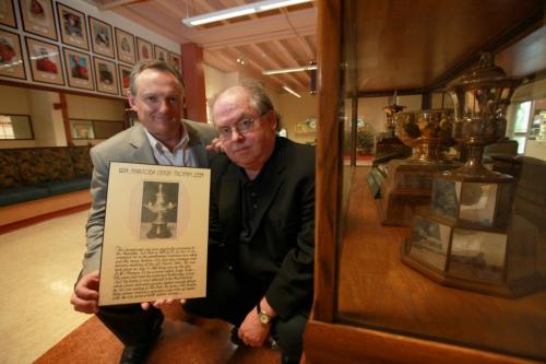 Assiniboia Downs CEO Darren Dunn - left and Horseracing historian Robert (Bob) Gates hold plaque with photo of the original Manitoba Derby trophy that was presented at the original Polo Park track and has gone missing.  See Al Besson's story. Sept 13,  2012 (Ruth Bonneville/Winnipeg Free Press)