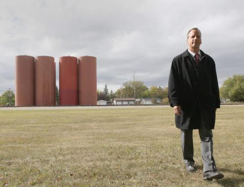 City of Winnipeg councilor John Orliko walks away from giant metal silos being that were erected on the BNSF Railway line on Lindsay Street and Mathers Avenue last week- local residents say they do not belong in a residential neighborhood – See Alex Paul story – September 17, 2012   (JOE BRYKSA / WINNIPEG FREE PRESS)