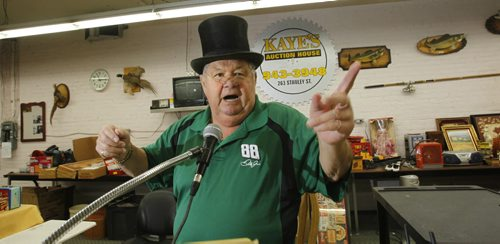 Sunday Xtra. Auctioneer Andy Kaye owner of Kaye's Auction House Inc. on Stanley St. shows some of his auctioneering skills. He is wearing the top hat and glasses he keeps on display.         (WAYNE GLOWACKI/WINNIPEG FREE PRESS) Winnipeg Free Press  Oct.18  2012