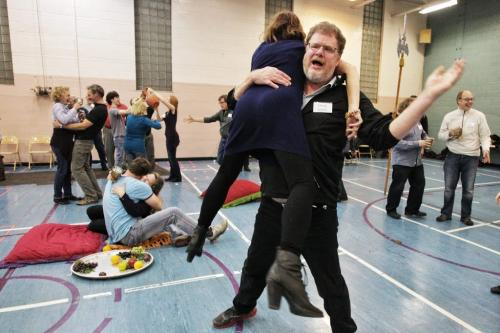 Courtier Doug Speirs picks up Bonita Reimer a woman of the court during a rehearsal for Rigoletto a Manitoba Opera production at Westworth United Church Wednesday night.  121114 November 14, 2012 Mike Deal / Winnipeg Free Press