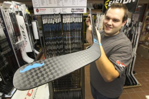 Kyle Johanson - Store Manager  of Source for Sports on Pembina shows special Sherwood hockey sticks made for his store for Movember fundraising efforts -  See Geoff Krybson story– November 15, 2012   (JOE BRYKSA / WINNIPEG FREE PRESS)