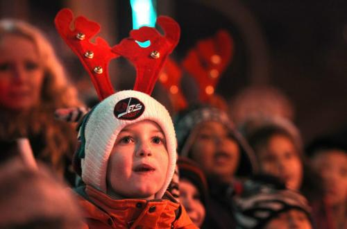 Crowds of wide eyed children gather with thier famiilies  along Portage Ave. Saturday evening during the annual Santa Claus Parade. Noah Brown - 7 yrs watches the parade Saturday. Nov 17 ,  2012 (Ruth Bonneville/Winnipeg Free Press)