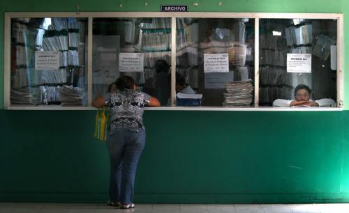 "A patient waits ""patiently"" for documents at Managua's Hospital Escuelda, Dr. Roberto Caulderon Gutierrez records window. Phil Hossack / Winnipeg Free Press October 25, 2012"