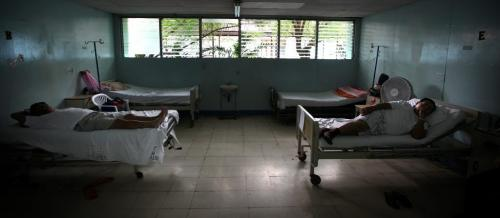 Patients wait on their beds for surgery in the men's ward in Managua. Phil Hossack / Winnipeg Free Press October 25, 2012
