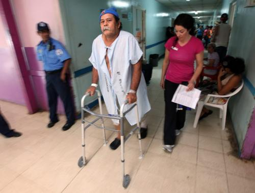 """Juan Canda explores the hallway past his recovery ward under the watchfull care of Op-Walk staff in Managua.  Juan received """"bi-lateral"""" surgery, both knees were replaced. Phil Hossack / Winnipeg Free Press  October 25, 2012"""