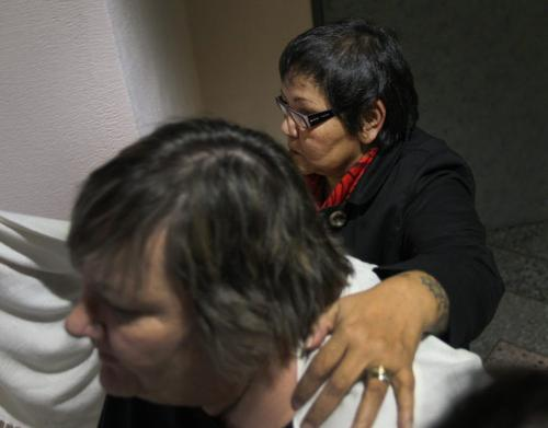 Delores Chief Abigosis, rear, a social worker testified today at the Phoenix Sinclair Inquiry– Here her advocate tries to block her face while leaving the inquiry for a lunch break Monday- See Carol Sanders story- November 26, 2012   (JOE BRYKSA / WINNIPEG FREE PRESS)