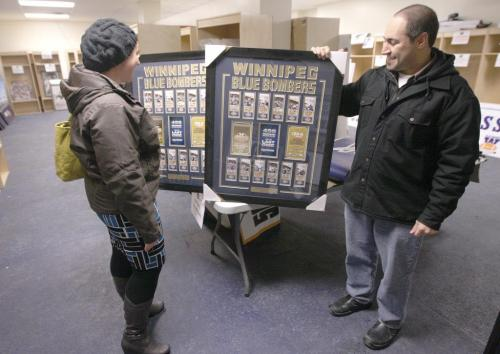 Winnipeg Blue Bomber season ticket holders Nichole Swain and Future brother Peter Combiadakis look at Bomber ticket frames they planned to buy at Canad Inns Stadium. Many other items and memorabilia  were for sale for season ticket holders until Dec 02 when the general public will be invited.-Standup Photo-November 29, 2012   (JOE BRYKSA / WINNIPEG FREE PRESS