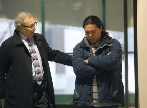 Father Steve Sinclair of  the late Phoenix Sinclair is briefed by lawyer Jeff Gindin before he enters the Phoenix Sinclair inquiry. He was to testify for the first time this morning at the Winnipeg Convention Centre. Today will be his first time he has had a chance to respond about how the social workers handled him and his daughters case. - See Carol Sanders and Lindor Reynolds story and column- December 05, 2012   (JOE BRYKSA / WINNIPEG FREE PRESS)