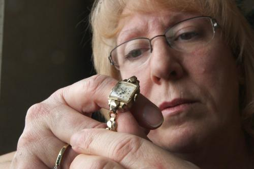 Sherry Winterburn holds a watch that was given to her that belonged to her great-aunt Edith Smallpiece who was believed to have been murdered on Feb 23, 1973- To this date it is a cold case in the Winnipeg Police Service's homicide list- See Dave Baxter story- December 06, 2012   (JOE BRYKSA / WINNIPEG FREE PRESS)