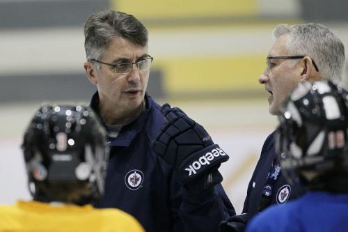 Winnipeg Jets coach Claude Noel and new assistant coach Perry Pearn (R) coach a minor league hockey camp at MTS Iceplex Monday, December 10, 2012. (John Woods/Winnipeg Free Press)