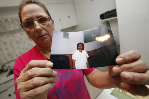 In her Selkirk home Tuesday, December 11, 2012 Sandra Hohne holds a photograph of her sister Gloria Sanderson who died in a fire Monday, December 10 in Selkirk. (John Woods/Winnipeg Free Press)