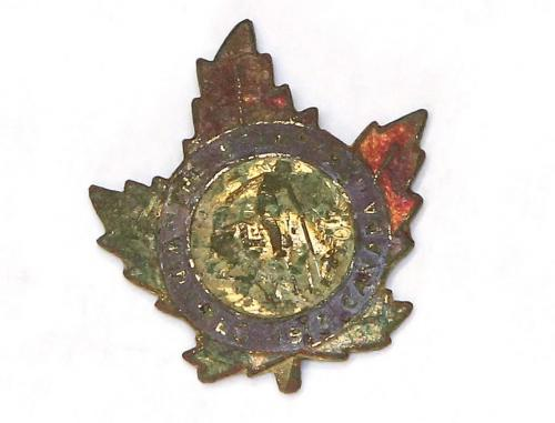 Malcolm Taylor's 1913 Winnipeg Rodeo pin that was sent to him from an old Navy buddy who found it while digging around in Nottinghamshire, England, Friday, December 14, 2012. (TREVOR HAGAN/WINNIPEG FREE PRESS)