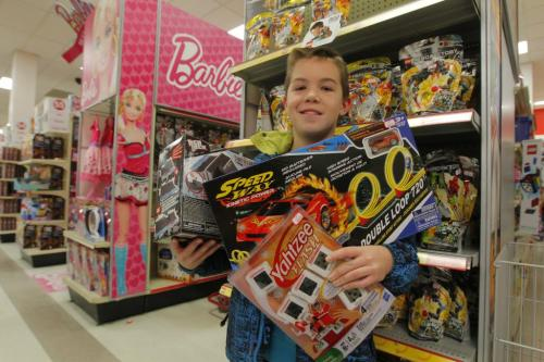 Alex Kirbyson with some toys for a Free Press basket. December 21, 2012  BORIS MINKEVICH / WINNIPEG FREE PRESS