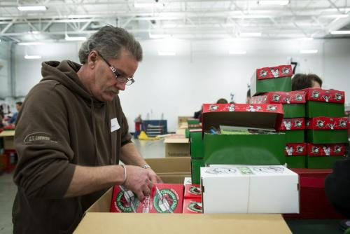 Henry Friesen of Steinbach, Manitoba helps pack boxes at the Samaritan's Purse operation during the Christmas season in Calgary, Alberta, December 3, 2012. In 1993, Operation Christmas Child grew and was adopted by Samaritan's Purse, a Christian organization run by Franklin Graham. To date, Operation Christmas Child has collected and distributed over 94 million shoe box gifts worldwide.  Each shoe box gift is filled with hygiene items, school supplies, toys, and candy, is given to children regardless of gender, race, religion, or age. Photograph by Todd Korol for The Winnipeg Free Press