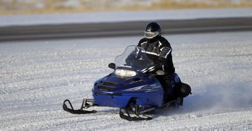 A snowmobiler heads to the 59er on Highway 59, Saturday, December 29, 2012. (TREVOR HAGAN/WINNIPEG FREE PRESS)