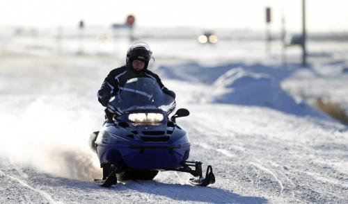 A snowmobilers departs from the 59er on Highway 59, Saturday, December 29, 2012. (TREVOR HAGAN/WINNIPEG FREE PRESS)