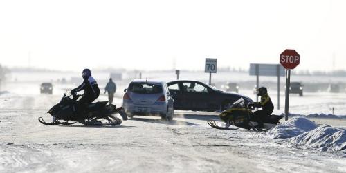 Snowmobilers pull into the 59er on Highway 59, Saturday, December 29, 2012. (TREVOR HAGAN/WINNIPEG FREE PRESS)