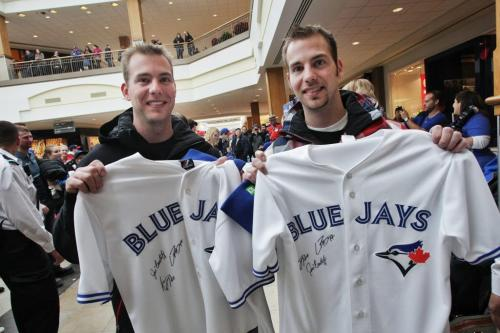 Twins Barret (left) and Braden Frith, 27, with the jerseys they had autographed by the Toronto Blue Jays who are in town while on a cross country fan appreciation tour. Organizers of the event are unofficially saying around 2500 fans showed up to get a chance to meet Jays' Brett Cecil, Aaron Loup and Jose Bautista at Polo Park Shopping Centre.  130106 January 6, 2013 Mike Deal / Winnipeg Free Press