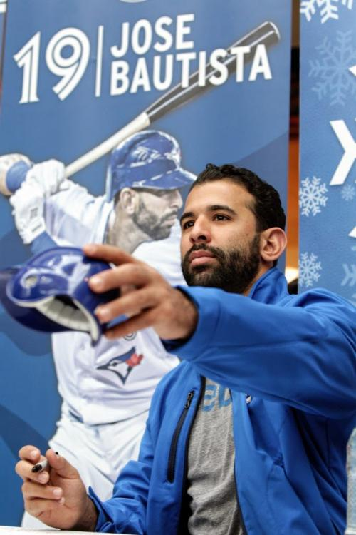Fans wait in line to get an autograph from Toronto Blue Jays Jose Bautista and his team mates who are in town while on a cross country fan appreciation tour. Organizers of the event are unofficially saying around 2500 fans showed up to get a chance to meet Jays' Brett Cecil, Aaron Loup and Jose Bautista at Polo Park Shopping Centre.  130106 January 6, 2013 Mike Deal / Winnipeg Free Press