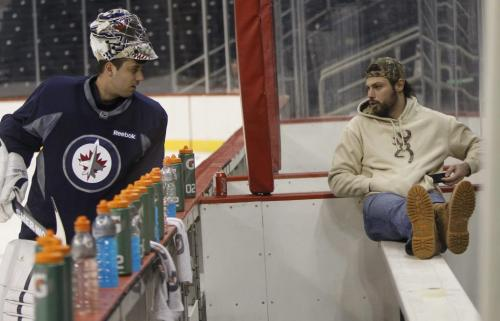 Goaltender Ondrej Pavelec speaks to Zach Bogosian recovering from an injury while the  Winnipeg Jets have  an informal practice in the MTS Centre Thursday. Ed Tait story  (WAYNE GLOWACKI/WINNIPEG FREE PRESS) Winnipeg Free Press  Jan. 10 2013