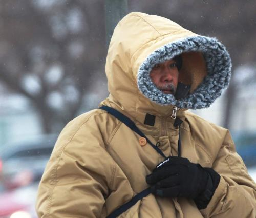 Bring it On-This man is prepared for high winds and snow on Notre Dame Ave and Balmoral St  that is predicted friday afternoon- The weather will get frightful throughout the day and overnight as Environment Canada has forecasted blizzard conditions into Saturday morning-Standup Photo- January 11, 2013   (JOE BRYKSA / WINNIPEG FREE PRESS)