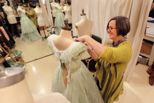 Costume designer Judith Bowden reckons there are around 200 costumes in all and Scarlett O' Hara herself has 17 costumes. Portraits of Bowden puts the finishing touches on Scarlet's iconic barbeque dress in the sewing area of MTC. Jan 09, 2013, Ruth Bonneville  (Ruth Bonneville /  Winnipeg Free Press)